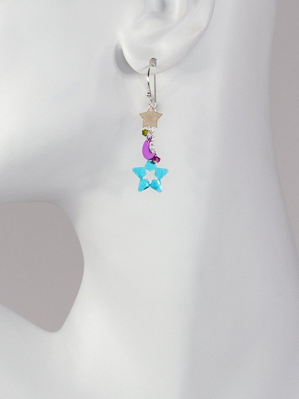 moon and star earrings on mannequin