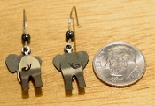 Back of elephant earrings with dime for scale