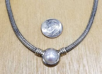 close up of fresh water pearl and sterling silver woven side necklace