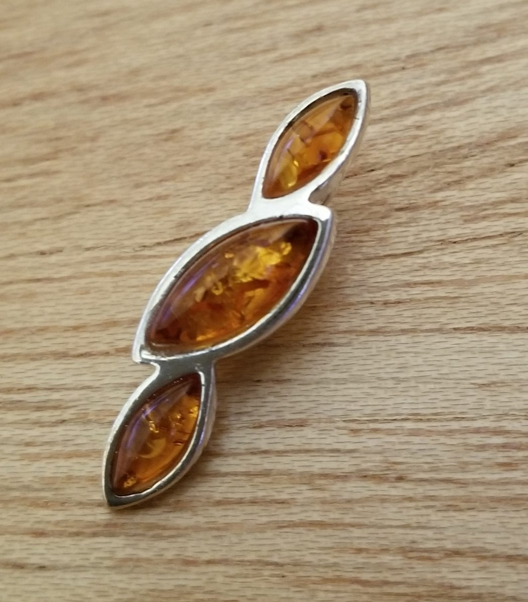 Modern Baltic amber three stone pendant