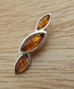 Modern Baltic amber three stone pendant