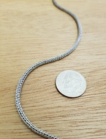 sterling silver handwoven wheat chain close-up with dime for scale