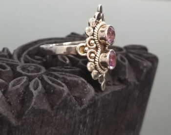 side view of amethyst two stone ring