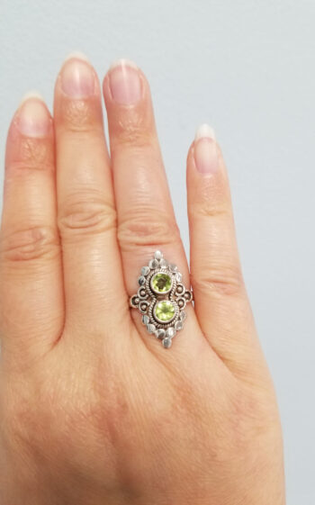 peridot ring on hand