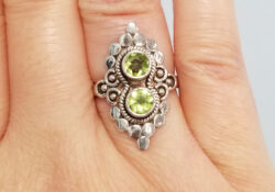 peridot and sterling silver ring on hand
