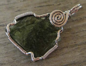 Handmade moldavite and sterling silver wire wrap pendant back view