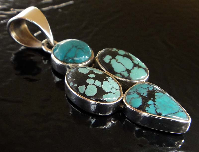 Four stone turquoise and sterling silver pendant close up