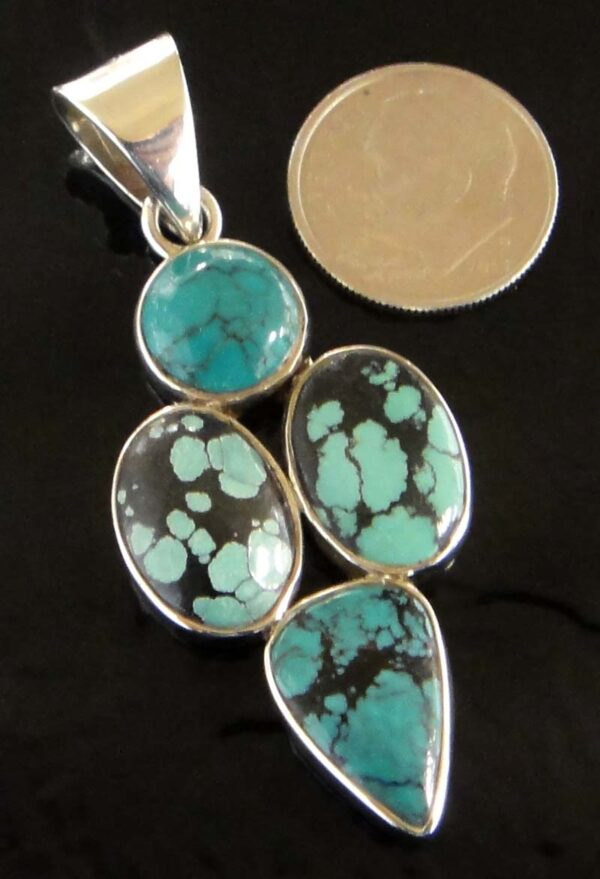 Four stone turquoise and sterling silver pendant with dime