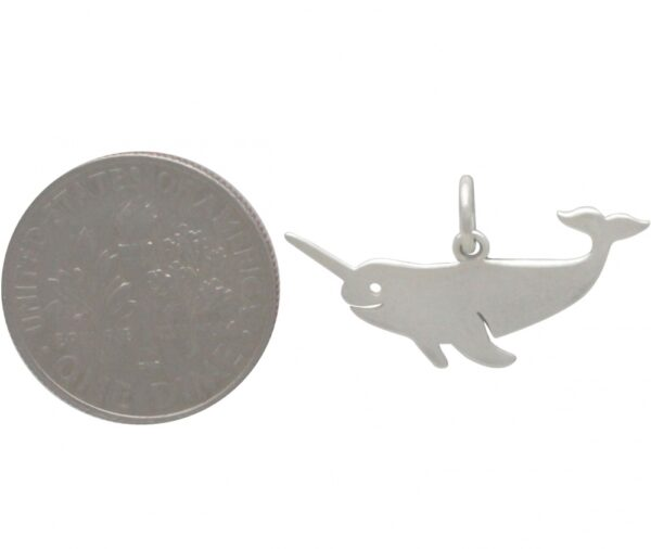 narwhal charm with dime for scale
