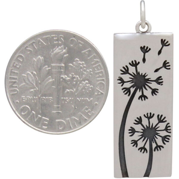 dandelion pendant with dime to show scale