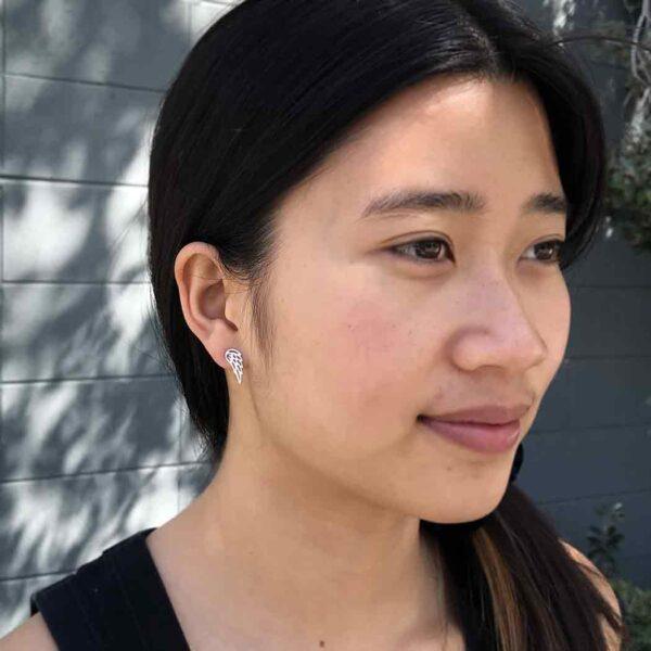 angel wing earrings on model