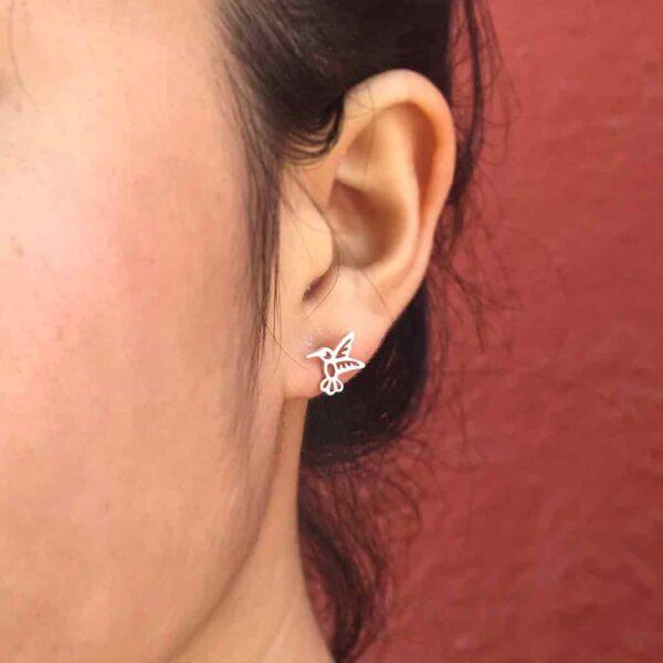 hummingbird stud earrings on ear