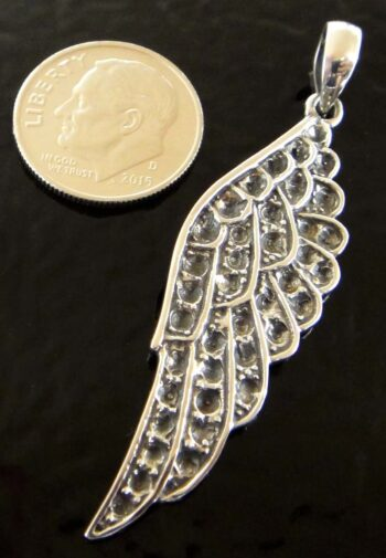 detailed sterling silver wing pendant with dime for size