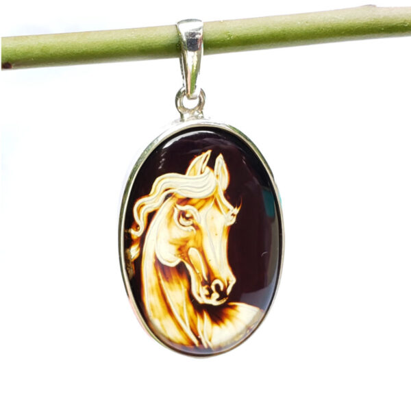Carved horse Baltic amber and sterling silver pendant