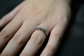 diamond and 14K white gold ring on hand