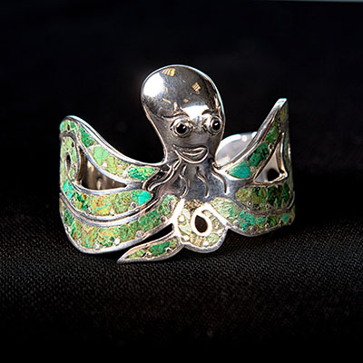 This sterling silver and green turquoise cuff bracelet was handmade by silver-smiths in Taxco, Mexico.