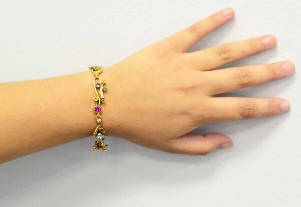 Ingenue style gold tone bracelet by Patricia Locke modeled on wrist