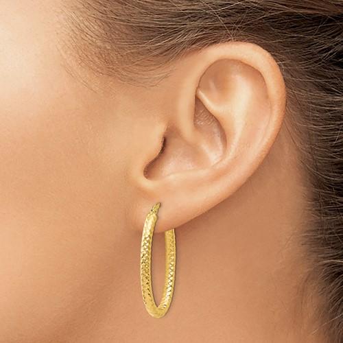 14k yellow oval textured hoop earrings
