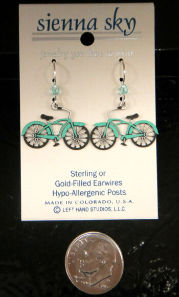These light blue bicycle earrings are handmade by Sienna Sky and pictured with a dime for scale.