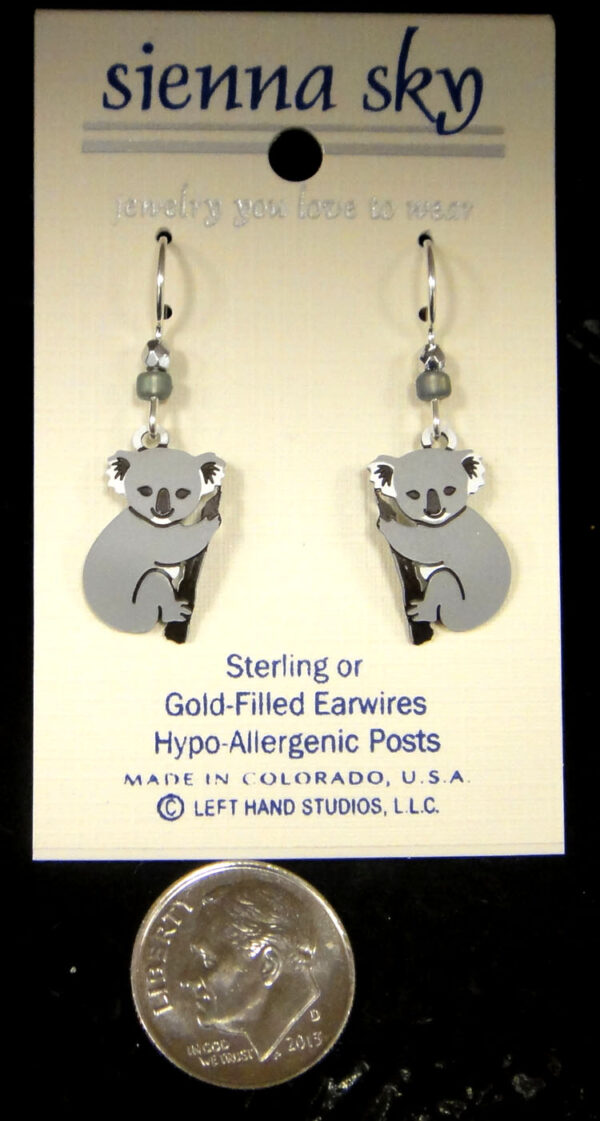 Koala bear earrings on earring card with dime for scale