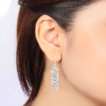 laborite leaf column and sterling silver earrings on ear