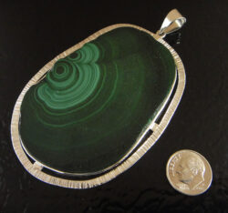 Green malachite slice and silver pendant