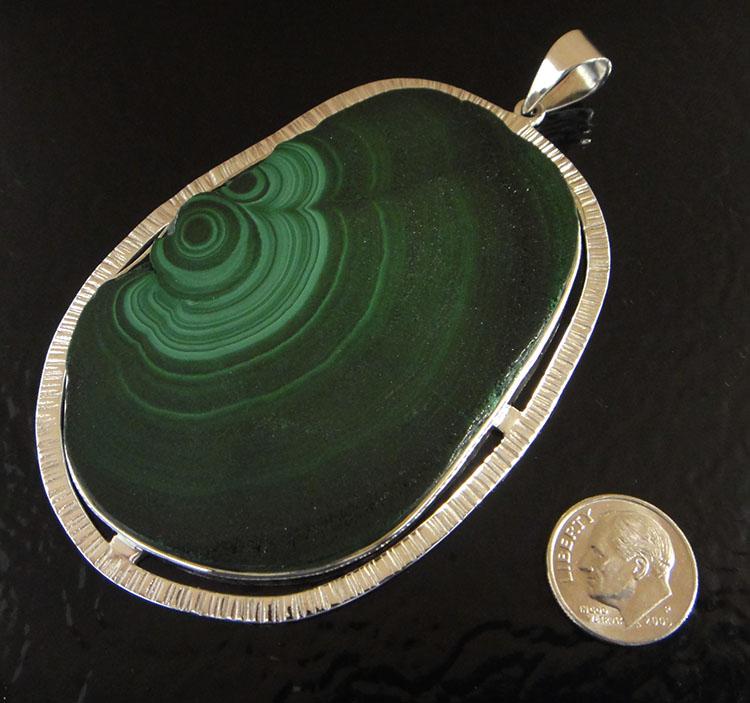Green malachite slice and silver pendant