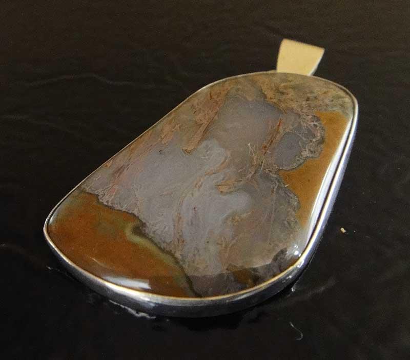 Handmade thunderegg jasper and sterling silver pendant