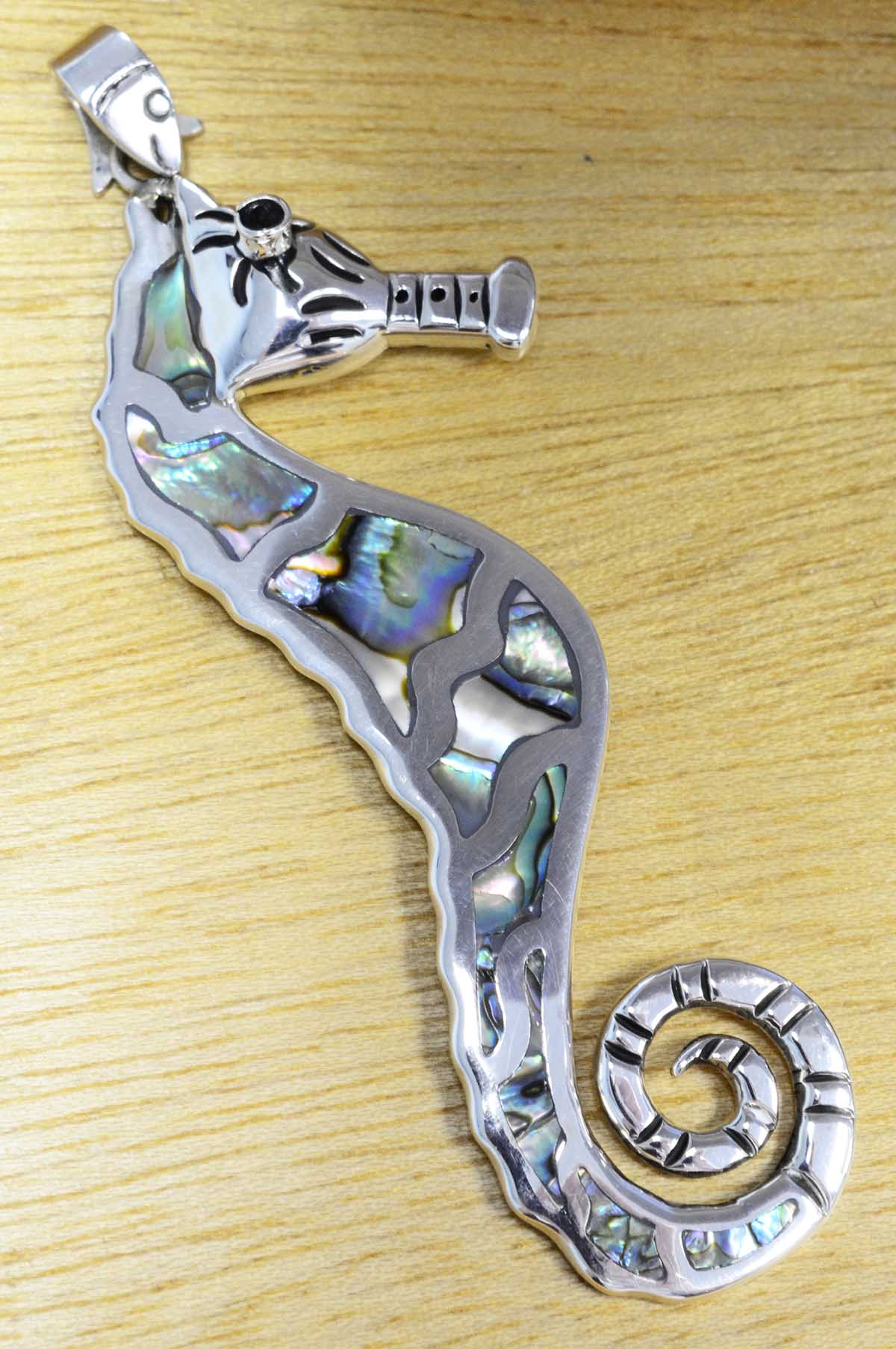 Abalone shell and sterling silver seahorse pendant