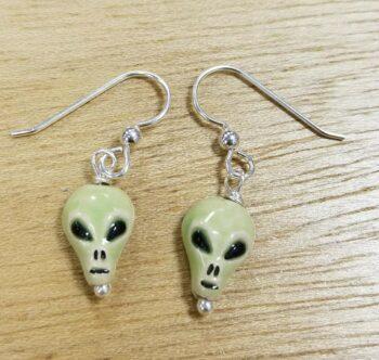 Green ceramic alien head earrings