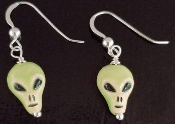 green alien ceramic earrings