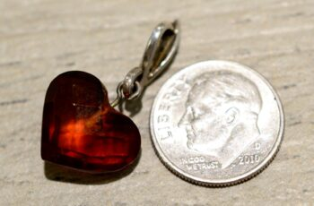 back of faceted heart amber pendant with dime