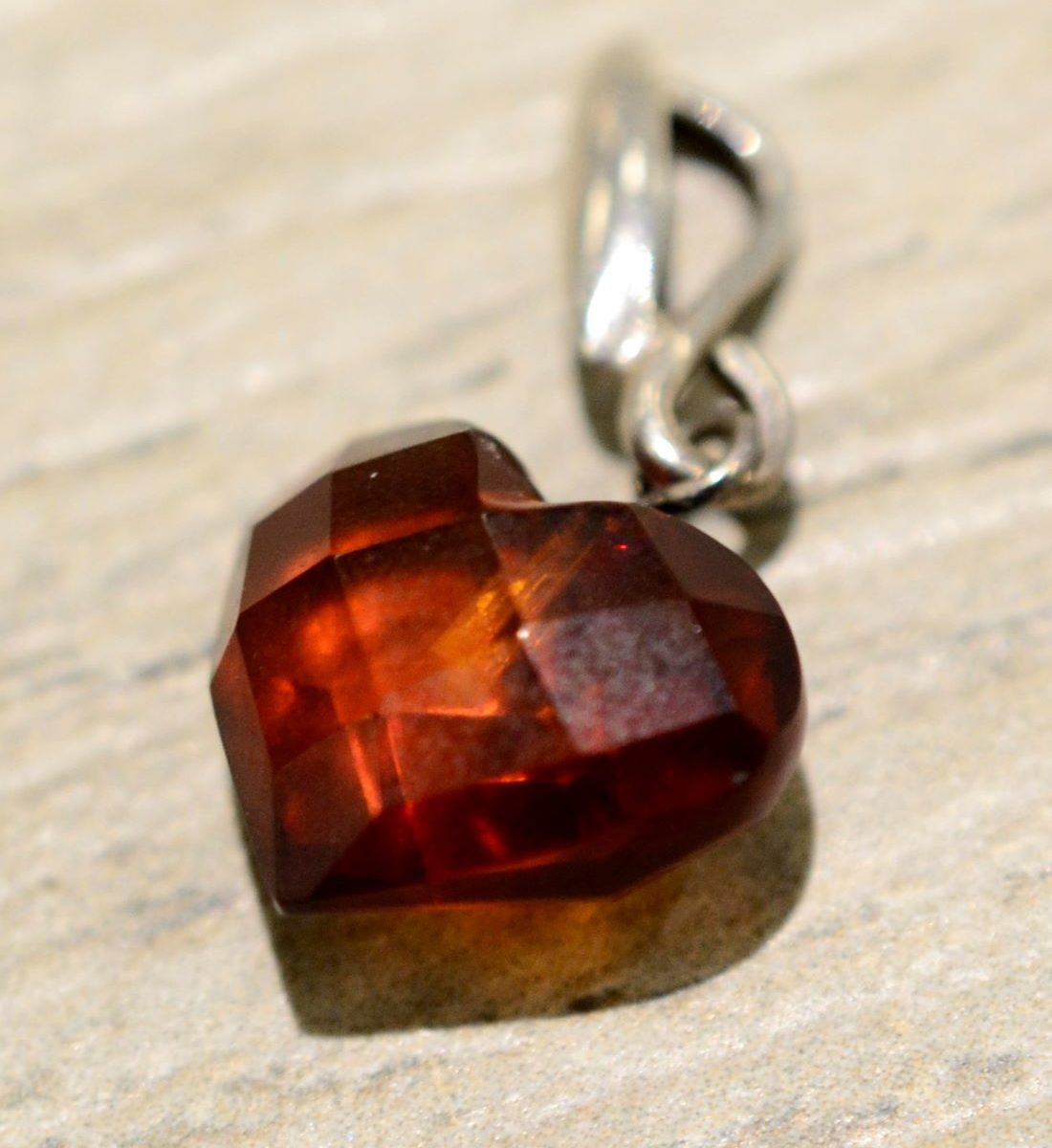 handmade faceted heart shaped amber pendant