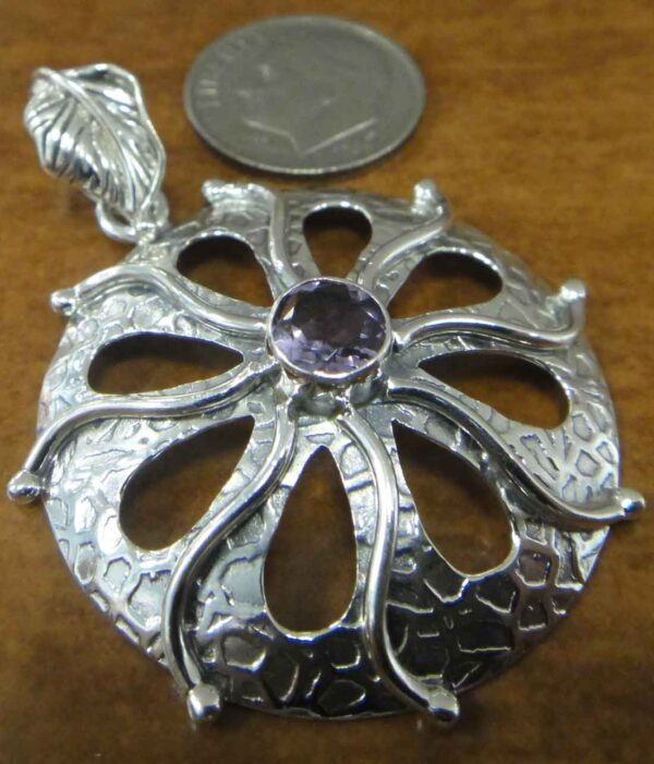 amethyst sterling silver textured circle pendant with dime for scale