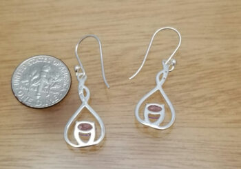 back of amethyst and sterling silver earrings with dime to help gauge scale