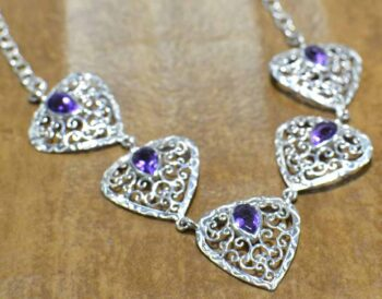 Amethyst and sterling silver filigree heart necklace close up