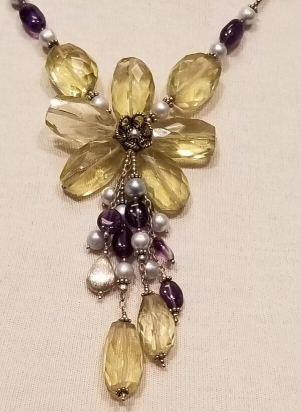 close up of amethyst, lemon quartz flower necklace
