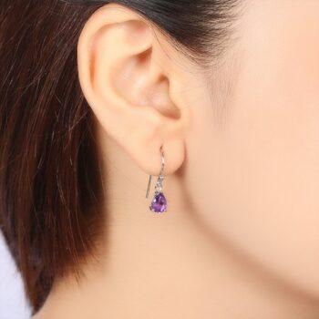 petite purple amethyst gemstone sterling silver drop earrings on ear for scale