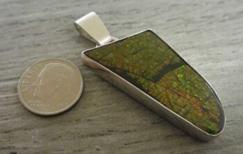 ammolite pendant with dime for size