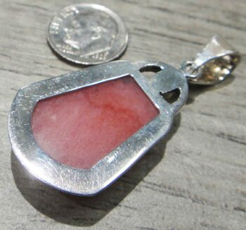 back of handmade pink opal and yellow citrine pendant with dime for size