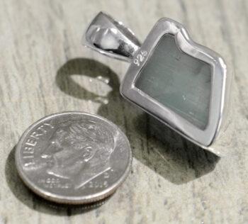 back of handmade geometric aquamarine pendant with dime