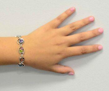 Penny Arcade bracelet by Patricia Locke modeled on wrist