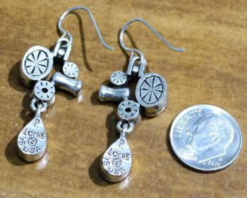 back of Arcana earrings by Patricia Locke with dime for size