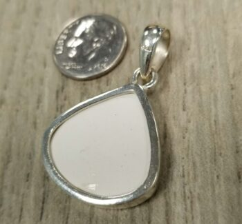 back of pendant with dime for scale