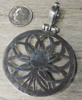 back of handmade Anna King art glass flower pendant with dime