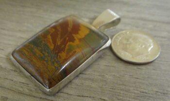 autumn leaf jasper pendant with dime for size