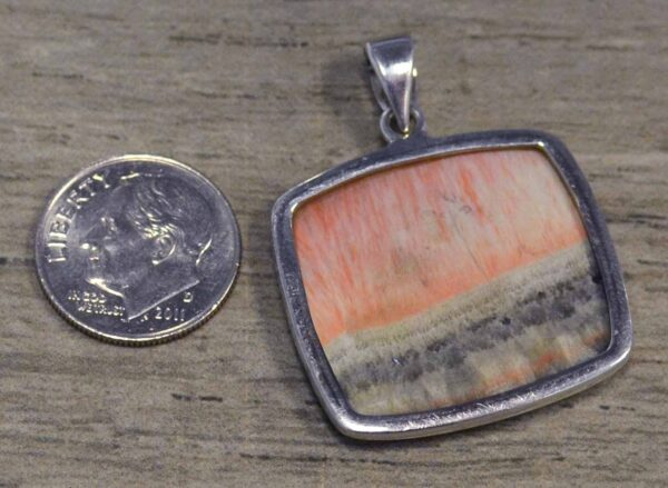 Handmade barite and sterling silver pendant back