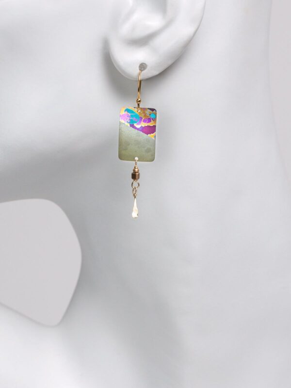 sage earrings on mannequin