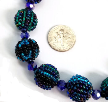 blue beaded necklace with dime for scale