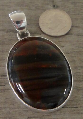 Handmade black and red petrified wood and sterling silver pendant
